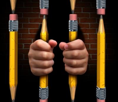Image of a person behind prison bars made of #2 school pencils.