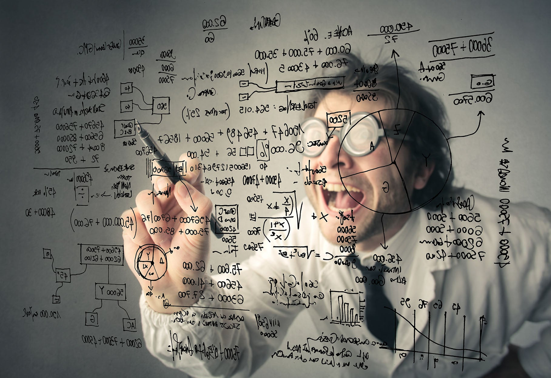 mad scientist writing formulas at the glassboard