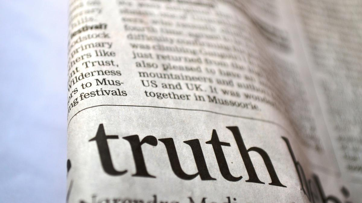newspaper with the word truth on it