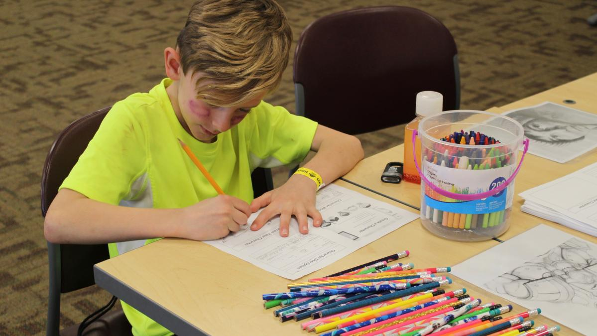 Young author at work on writing activity