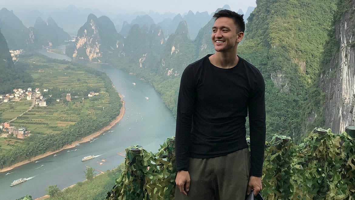 ASU grad Thomas Quiroz in the hills of Guilin, China, during study abroad