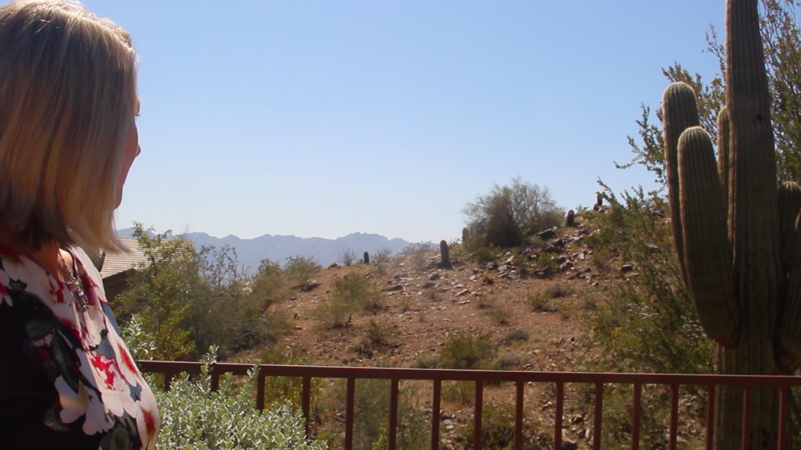 ASU principal lecturer, founder of Superstition Review Patricia Colleen Murphy outside her home in Ahwatukee