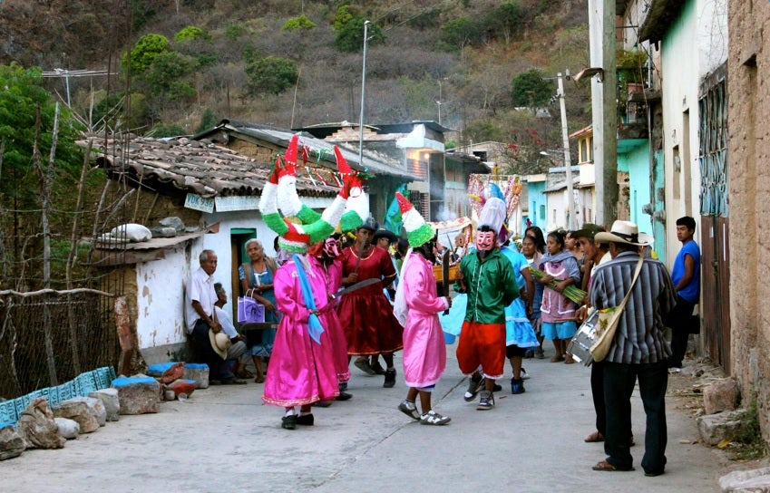 Nahua/Mexicano community dance in the streets during a celebration